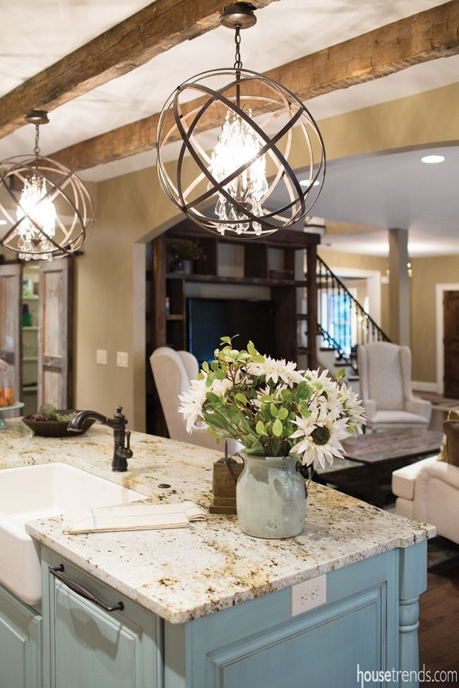 Pretty light fixtures over kitchen island island color wood beams