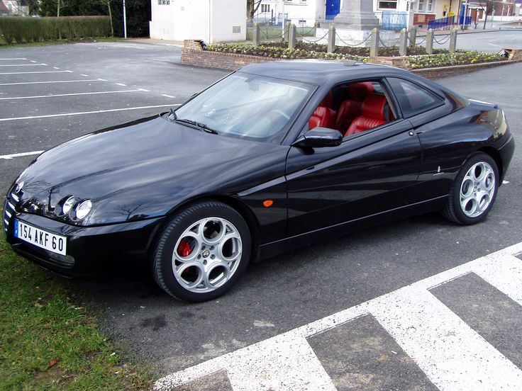Black Alfa Romeo GTV (post 2003) with 3.2 V6 engine, red leather interior and GTA wheels.