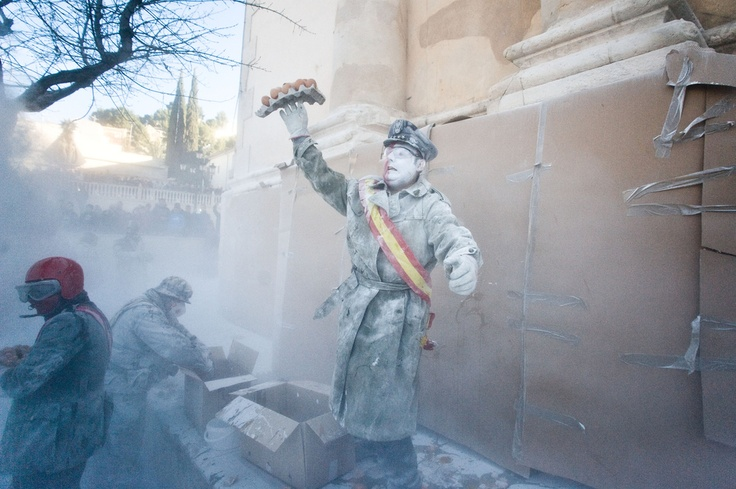Residents of Ibi, Spain, take part in an annual Dec. 28 flour fight as part of the Els Enfarinats festival.