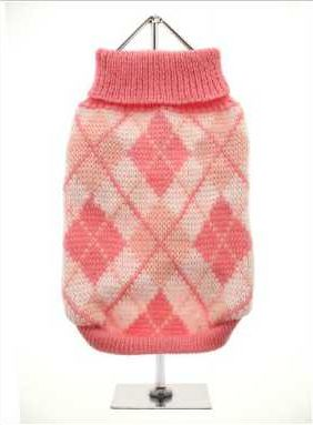Knitted pink sweater with a baby pink and white diamond pattern. The Argyle pattern has seen a resurgence in popularity in the last few years due to its adoption by Stuart Stockdale in collections produced by luxury clothing manufacturer, Pringle of Scotland. The rich Scottish heritage will give your pup a touch of class while keeping warm!