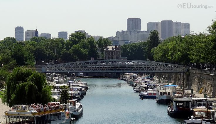 Showing the North side of Passerelle Mornay it connects the Boulevard de la Bastille and the Boulevard Bourdon and crosses over the Canal Saint-Martin.  More photos to be seen at www.eutouring.com/passerelle_mornay.html