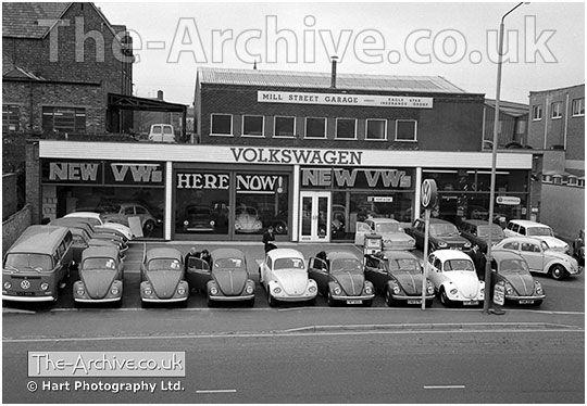 VW Beetles & A Volkswagen Van on the frontage of Mill Street Volkswagen Garage, Stourbridge Road, Stourbridge, West Midlands, Worcestershire. Photograph in 1968