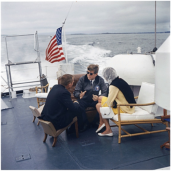 """President Vacations in Maine. Under Secretary of the Navy Paul Fay, President John F. Kennedy, Patricia Kennedy Lawford. Boothbay Harbor, ME, aboard the US Coast Guard Cutter """"Guardian 1""""., 08/12/1962"""