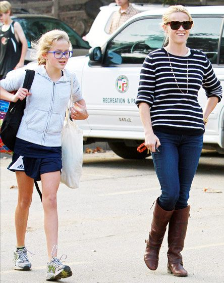Stepping out with her lookalike daughter, Ava, Reese Witherspoon stayed comfortable and chic -- a key factor in her hot mom style -- in a striped sweater, jeans and leather boots in L.A.