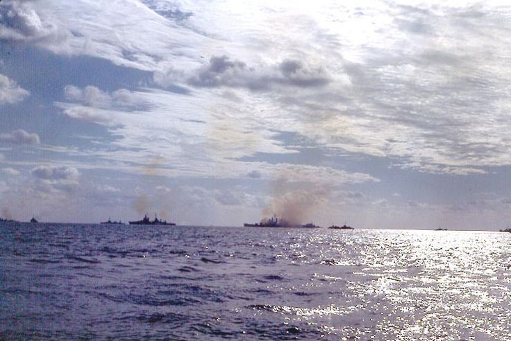 Cruisers Pensacola, Salt Lake City, Indianapolis, and an unidentified Cleveland-class cruiser bombarding Iwo Jima, 19 Feb 1945
