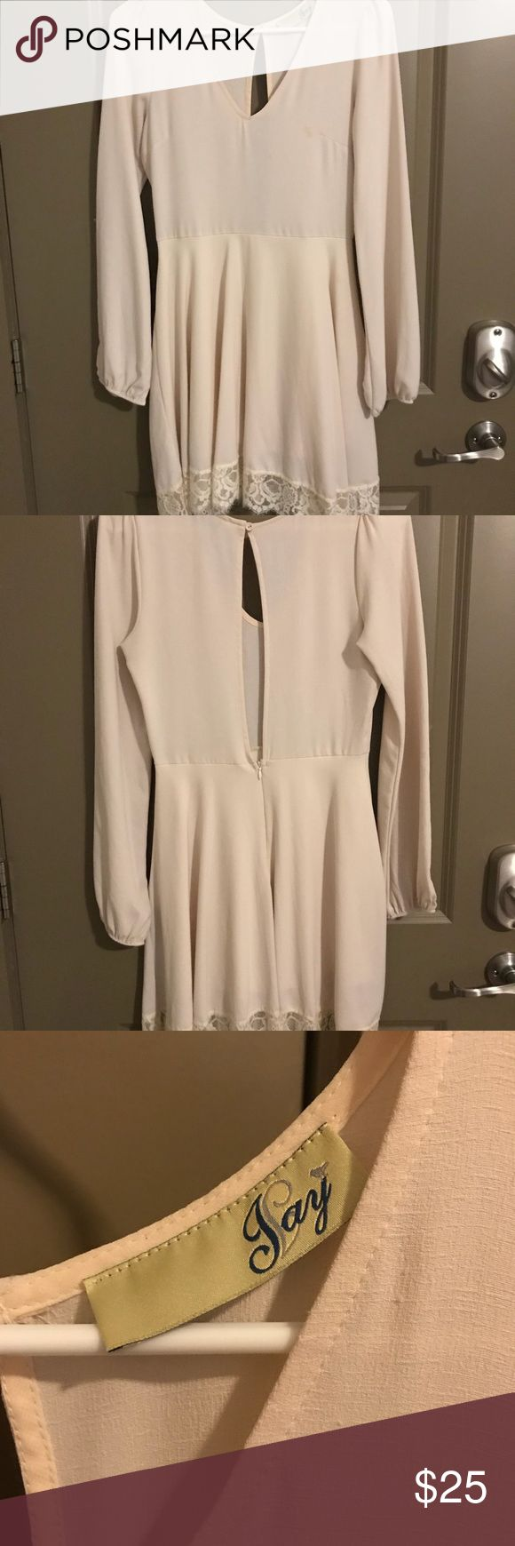 Cream long sleeve dress Cream long sleeve dress with beautiful lace trim and an open back. Only worn one time for a banquet. Very small stain on the breast Dresses