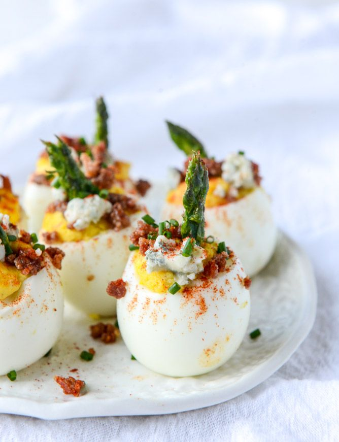 Bacon Blue Deviled Eggs with Roasted Garlic and Asparagus are for anyone who didn't think deviled eggs could be fancy.