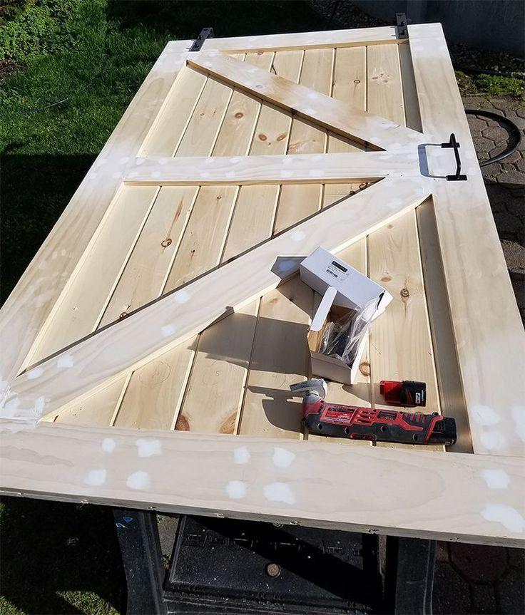 How To Build A Sliding Barn Door For Less The Honeycomb Home Diy Barn Door Plans Door Plan Building A Barn Door