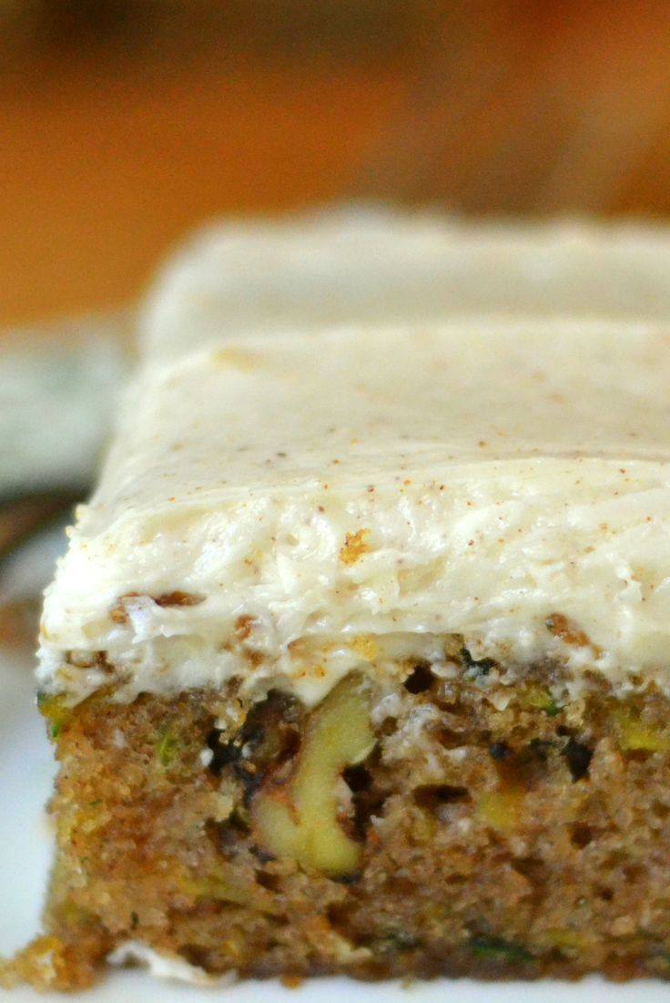 Fluffy zucchini cake packed with zucchini and walnuts, with a luscious browned butter frosting!