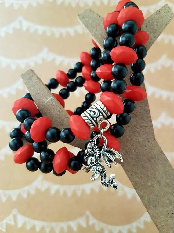 Check out this item in my Etsy shop https://www.etsy.com/au/listing/549470074/red-and-black-dragon-charm-bracelet