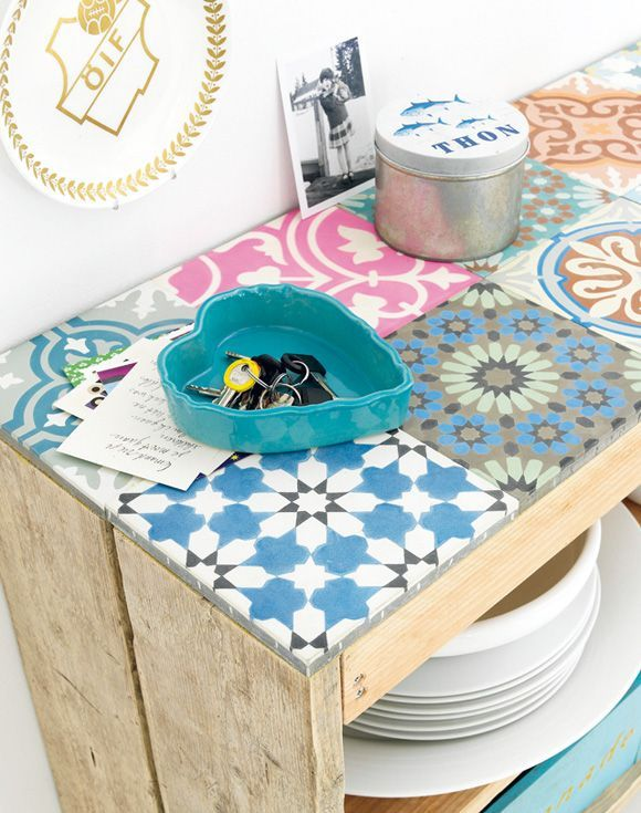 Patchwork floor tiles can be used on other surfaces, not just pretty floors. Used in this kitchen they are personal and fun, love the pastel colour choices too.