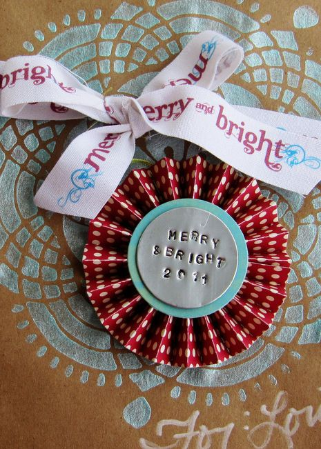 Brilliant! Use empty coke cans to create stamped metal tags to embellish everything from Christmas ornaments to wearable accessories!