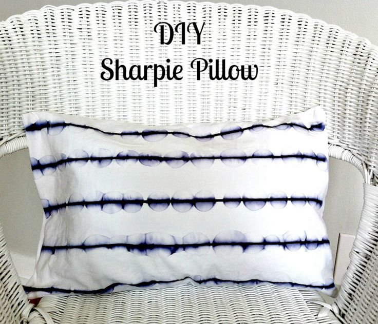 DIY Sharpie Pillow - Draw parallel lines, then use medicine dropper to drip rubbing alcohol, which causes watercolor circle effect. Iron to set.
