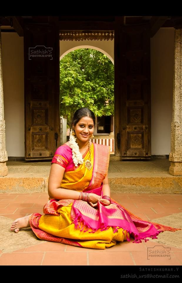 Beautiful saree.... Can see the essence of south india in the doors,stone pillars...wow!!