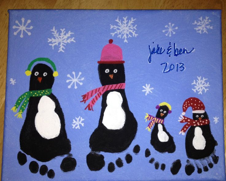 Penguin Footprint Art for Christmas.  Super easy craft for children using stretched canvas. I used acrylic paint for the blue background and penguin bodies, and paint markers for everything else.  An easy way to do painted footprint crafts with children is to set up in the bathroom (contain the mess / tile floor!) and fill the tub with warm water. As soon as your child is done making prints, stand the child in the tub and clean him/her up.