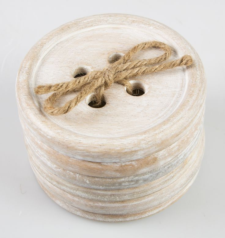 The Button Wood Coaster comes in a lovely set of 6 pieces.  The oversized buttons are made out of wood in a rustic, pale wood finish
