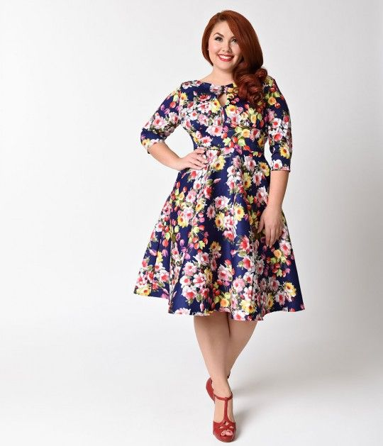We dont need reasons to wear Bouvier, gals! Captivating beauty, The Bouvier dress has arrived straight from Unique Vintage in a gorgeous navy blue woven blend with a gorgeous array of blooming floral bouquets, cut in a classic plus size retro style! Darl