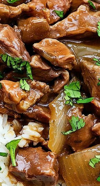 Slow Cooker Beef on Rice ~ Savory beef and gravy slow cooked to tender perfection and served over rice!