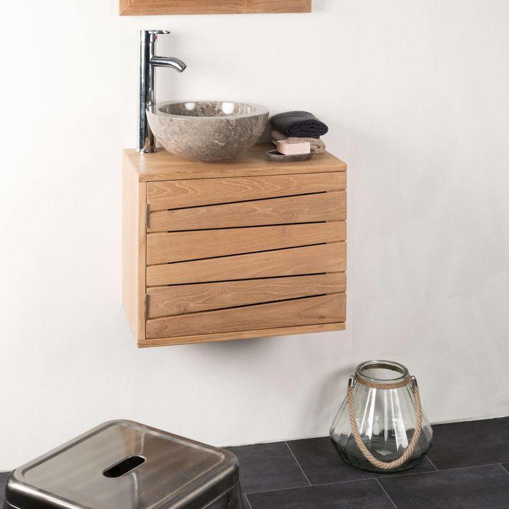 Choisissez ce meuble teck salle de bain suspendu pour créer une décoration unique dans votre salle bain. Ce meuble naturellement résistant à l'humidité, s'adaptera parfaitement dans des petits espaces ou pièce exigüe et permettra une organisation optimale de votre salle d'eau. Derrière sa porte aux lignes obliques vous pourrez installer vos serviettes ou accessoires de beauté. N'hésitez pas à intégrer la vasque en marbre grise Barcelonepour un ensemble élégant...