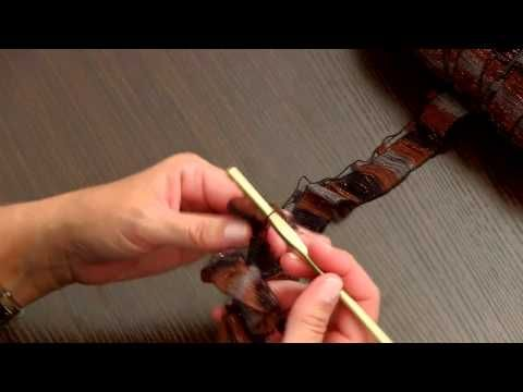 Learn the secrets to working with Red Heart Boutique Ribbons yarn. Kristin Omdahl takes you through winding the hank onto a tube and shows you how to crochet this flat ribbon yarn that makes wonderful little ruffles.