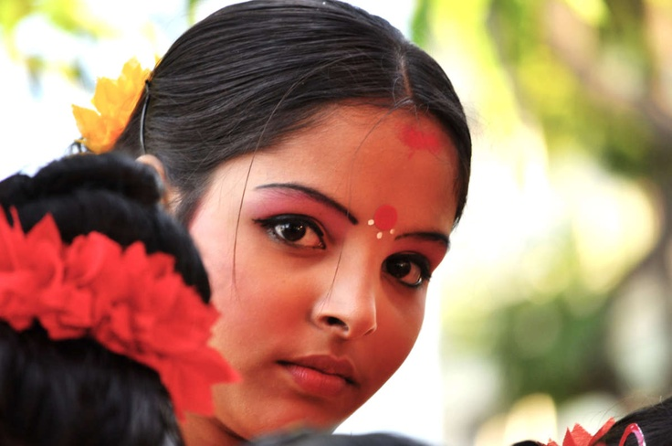 The charming lady awaits her turn - It is 14th April & this day is celebrated as the first day of the New Year for Bengalis in West Bengal in India. It is a day to celebrate ...