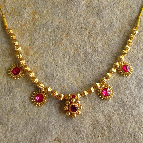 Indian design Kolhapur style necklace of gold and rubies.