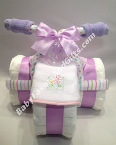 baby shower for a girl diaper display tricycle diaper cake