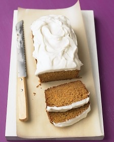 Grated carrot is the secret to the moistness and mellow sweetness of this loaf cake topped with thick swirls of tangy frosting.