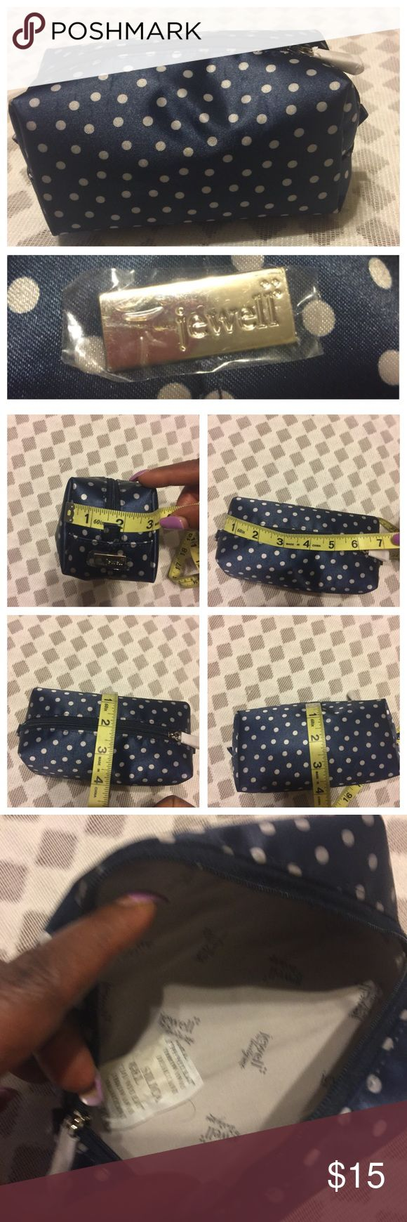 ***Jewell By Thirty-One***Cosmetic/Toiletry Bag. ***Jewell By Thirty-One***Cosmetic/Toiletry Bag. Navy and Tan color. See photos attached for measurements. New, Preowned but never been used. No tag, no hold, no trade, and no modeling. Jewell by Thirty One Bags Cosmetic Bags & Cases