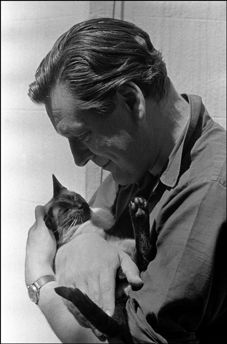 UK. England. London. Anthony Crosland, Minister of Education and Science in the Labour government of Harold Wilson. Here he is at home cuddling his pet Siamese cat. 1965