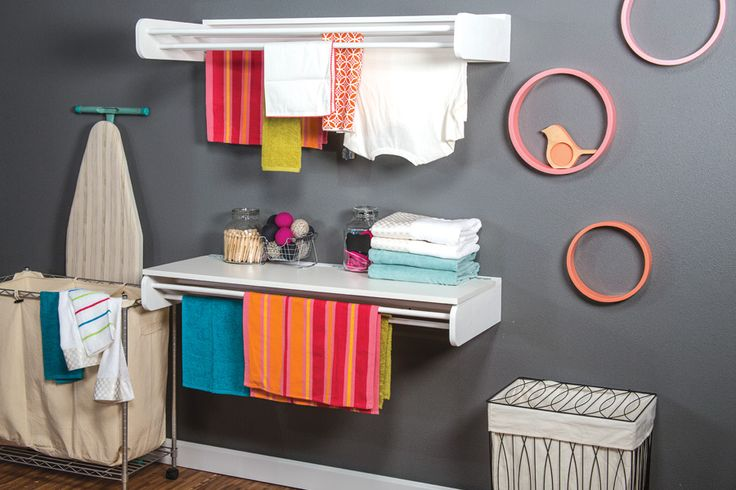 Declutter your laundry room with this dual-purpose laundry rack. It has long bars where you can hang clothes to dry, plus an optional hinged table that provides a perfect place for folding and sorting clothes.