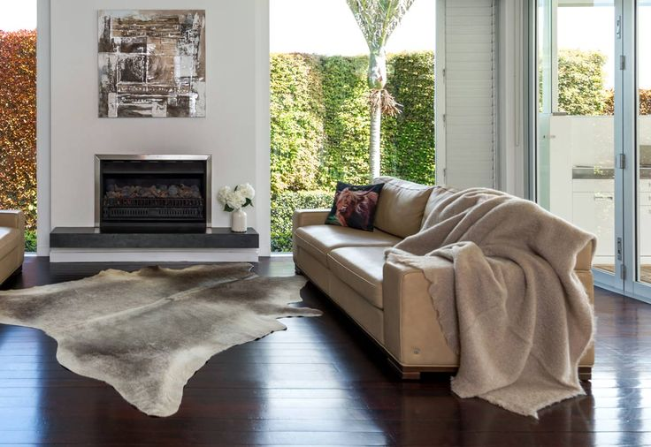 A beige mohair throw on a caramel leather sofa with a subtle grey cowhide rug. http://www.gorgeouscreatures.co.nz/shop/Mohair+Throws+%26+Blankets.html