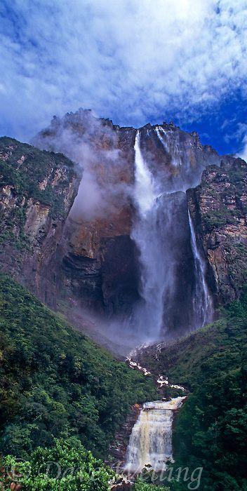 Angel Falls the tallest waterfalll in the world and Auyan tepui one of the sky islands rise up from the clouds and tropical rain forest in the wild and remote Lost World area of Canaima National Park, Venezuela