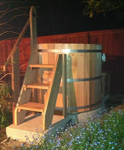 Standalone 4 person Cedar Jacuzzi hot tub with custom made stairs.