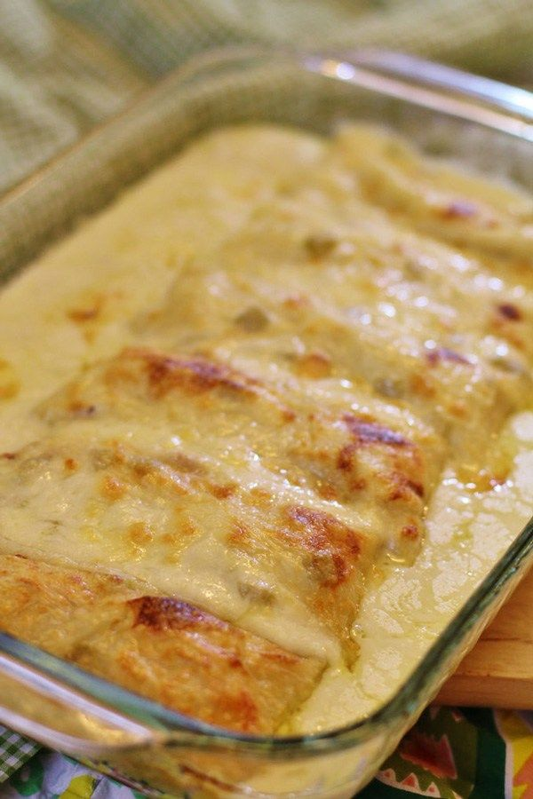 White Chicken Enchiladas - With T family changes. Use 1/2 chicken stock, 1/2 green enchilada sauce. Season chicken with Mexican spices or garlic, plus add slightly sautéed onions and a can of diced green chilies to the meat. Dip tortillas in green enchilada sauce and fill with meat mixture. Cover with enchilada sauce mixture, cheese, green onions, olives, and diced tomatoes. D loved these lots! - P
