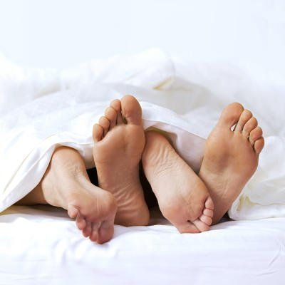 couple in bed, feet