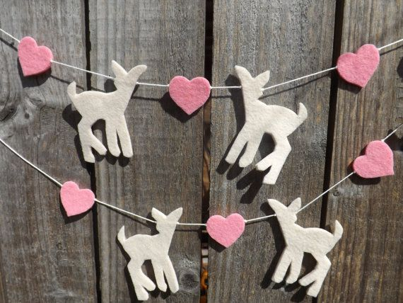 A pretty fawn garland interspersed with hearts and cut by hand with scissors in thick acrylic craft felt. There are six fawns in alternate poses. This garland would look sweet hung almost anywhere, but especially in a babies nursery or kids bedroom, at a window or below a shelf or