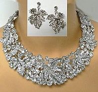 Look closely at this crystal choker set and you will see a pattern of sculptured maple leaves throughout the choker and angling in the earrings.  The crystal jewelry has a choice of cler crystal in silver plated settings or iridescent in gold plating.  Click the link to see this wholesale crystal necklace set and similar designs that will wow your customers.  http://www.awnol.com/store/Crystal-Jewelry/Crystal-Necklaces