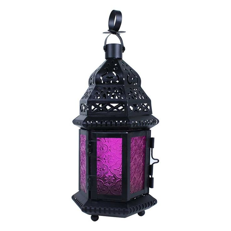 "This small lantern is only just over hand high. A good size for a votive candle (not included). Two panel door has a 2 3/4"" x 3 1/4"" opening. 10 1/4"" high with hoop up."