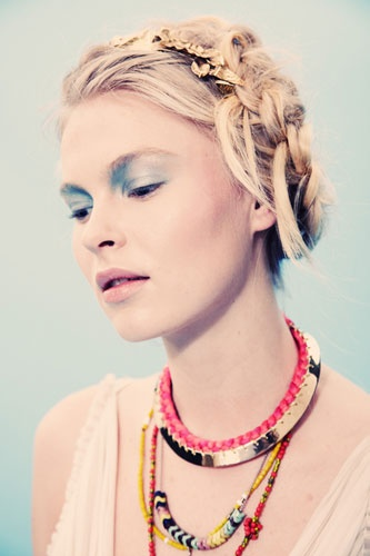 Try some unkempt milkmaid braids. Additional accessories like headbands are optional, but awesome.