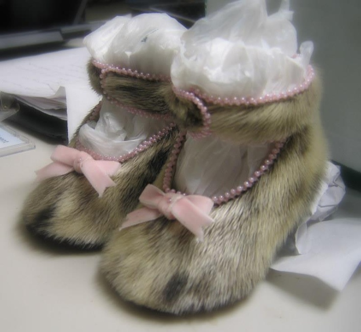 Made out of seal skin.... Ooh, I want to make a pair like this for my granddaughter... Super cute!