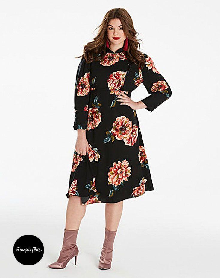 Rock the Oriental trend this season with this mandarin collar midi length printed dress.