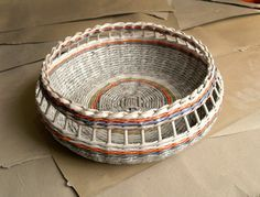 Make rolled paper 'wicker' baskets  I have just discovered how easy it is to weave a basket using newspaper! It's so simple to roll paper tubes out of newspaper and then weave the tubes into a basket. You can bet I will be making plenty of these faux wicker baskets for future projects, as well as for storage in the home.         I discovered this post on a Russian website and the instructions don't quite make sense, so I started putting together my own paper weave basket using newspaper…