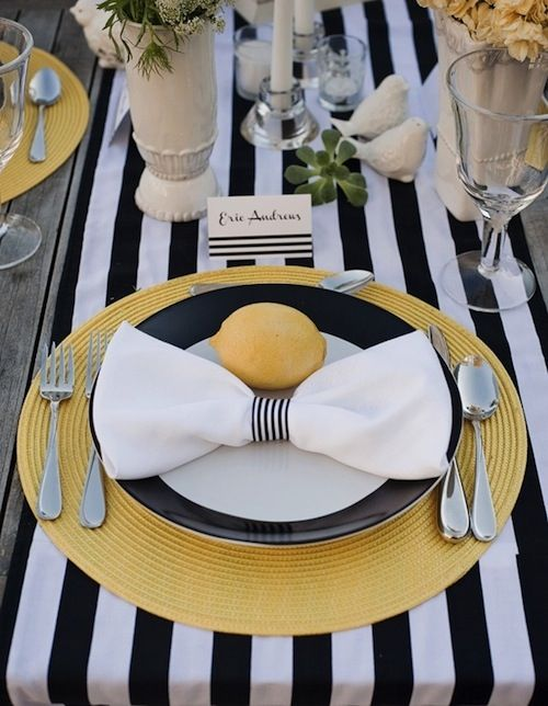 Black and white stripes can make a big impact on your tablescape. Use a striped runner or black and white plates for a classic look.