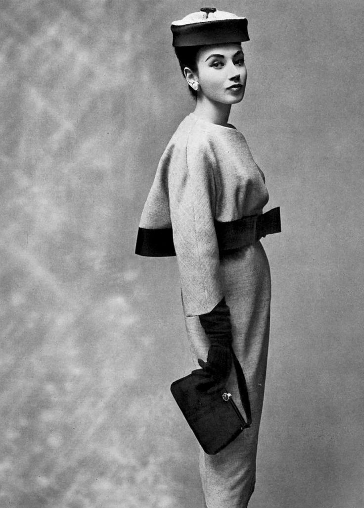 gray wool dress and grosgrain-trimmed bolero. Asian-inspired hat by Legroux. Photo: Georges Saad, 1957