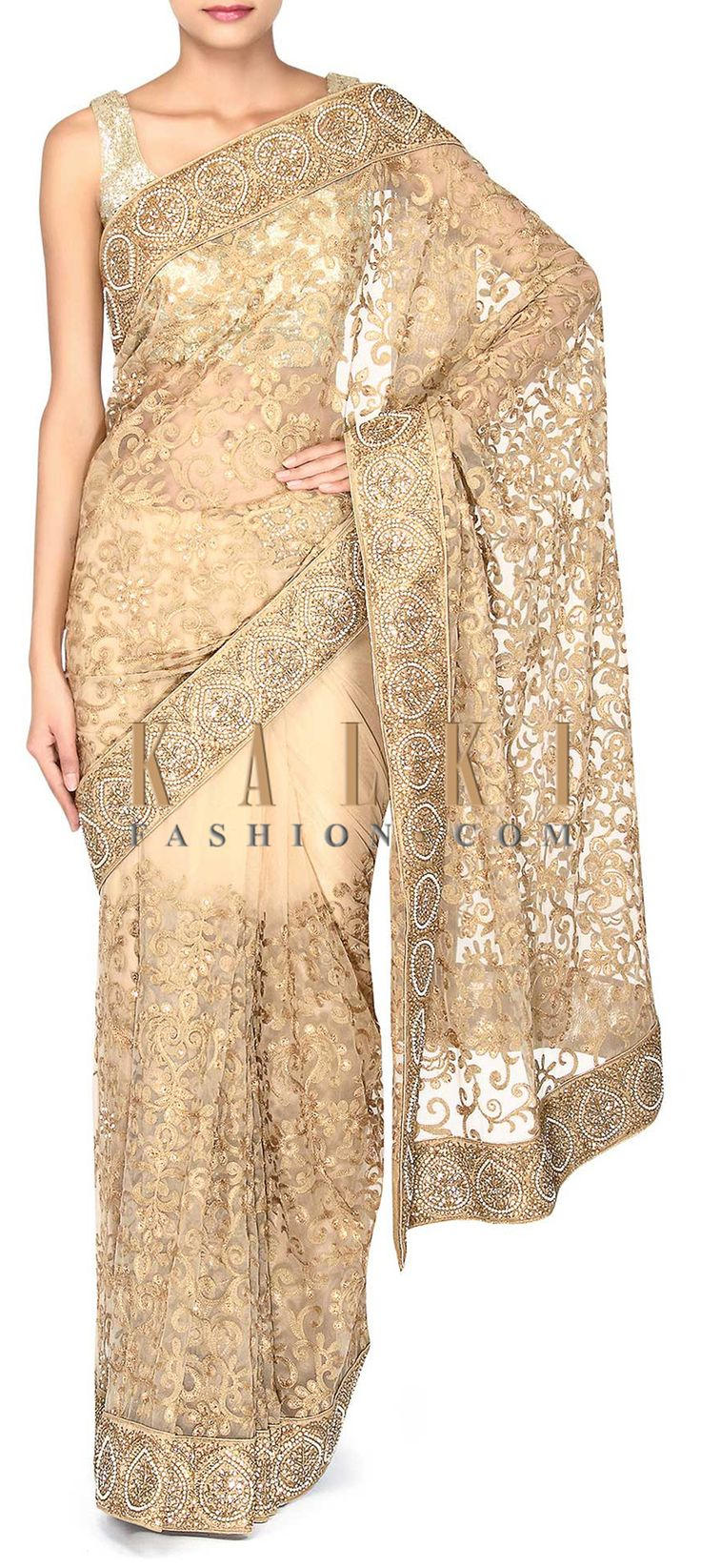 Buy Online from the link below. We ship worldwide (Free Shipping over US$100). Product SKU - 302887. Product Link - http://www.kalkifashion.com/beige-saree-adorn-in-resham-and-kundan-embroidery-only-on-kalki-18073.html