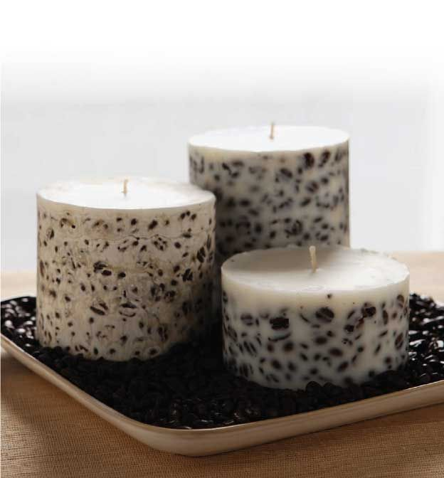 I used coffee beans to create these homemade soy candles, but dried flowers or chunks of colored wax would work well too.