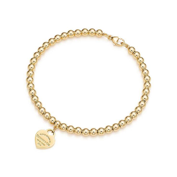 Return to Tiffany® mini heart tag in 18k gold on a bead bracelet. | Tiffany & Co. $1350