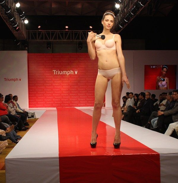 Model walking on the ramp wearing sexy lingerie from Triumph International at a fashion show held in Mumbai. #Style #Sexy #Fashion #Beauty #India #Lingerie
