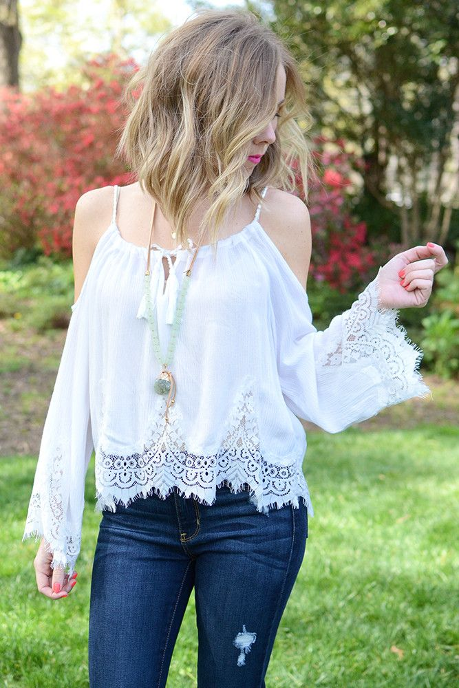 {B O H O} Vibes! This white cold shoulder lace top by Vintage Havana is the perfect addition to your boho chic collection. Treat your free spirit side to this top that features a lace scalloped hemlin
